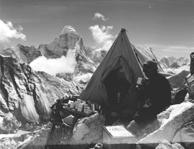 Sherpa drinking tea with Ama Dablam in the distance
