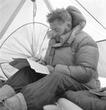 Charles Evans writing in his tent at Base Camp