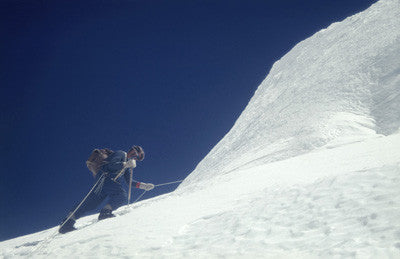 Wilfred Noyce on a rope ascending an ice face in the Khumbu Glacier
