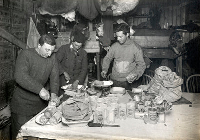 Dr. Atkinson, Henry Bowers and Apsley Cherry-Garrard cutting up pemmican