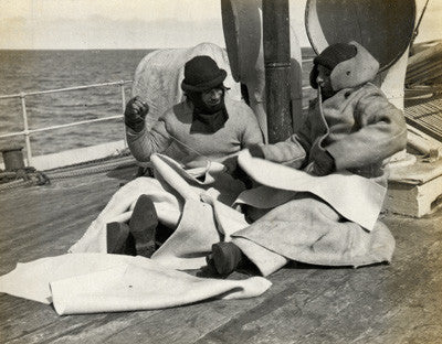 Sailors making clothing on the deck of the Terra Nova