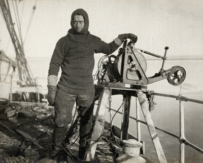Lieut. Harry Rennick at the sounding machine on board Terra Nova