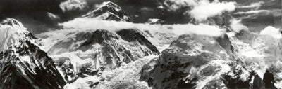 Landscape image of Mount Everest with clouds