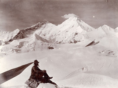 Team member in foreground with Mount Everest (east side) in distance