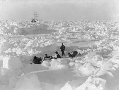 Dr. Leonard Hussey and dog team with Endurance frozen in the ice