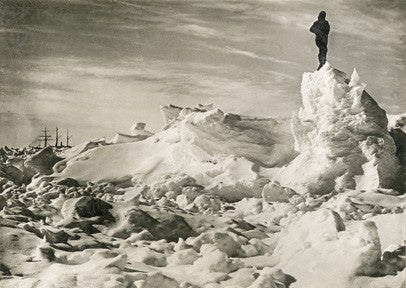 Crew member standing on the ice with Endurance in the background