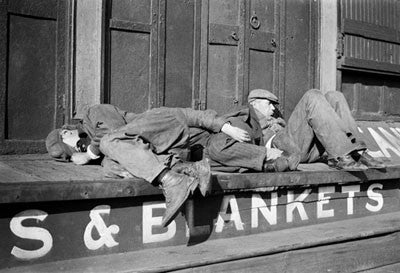 Unemployed men sleeping on shop steps during the Great Depression