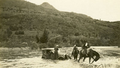 Gauchos pulling car from river in Argentinian Patagonia