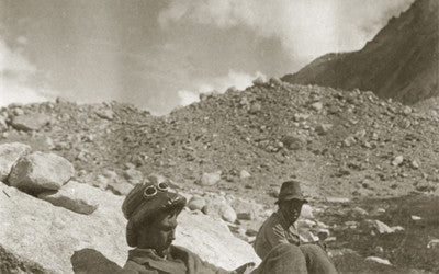 Expedition members resting; George Mallory reading