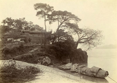 Isabella's boat moored by a temple on a promontory, Min river