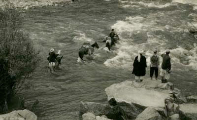 Fording a river in the Hindu Kush