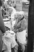 Women selling food at a railway station, Amazar
