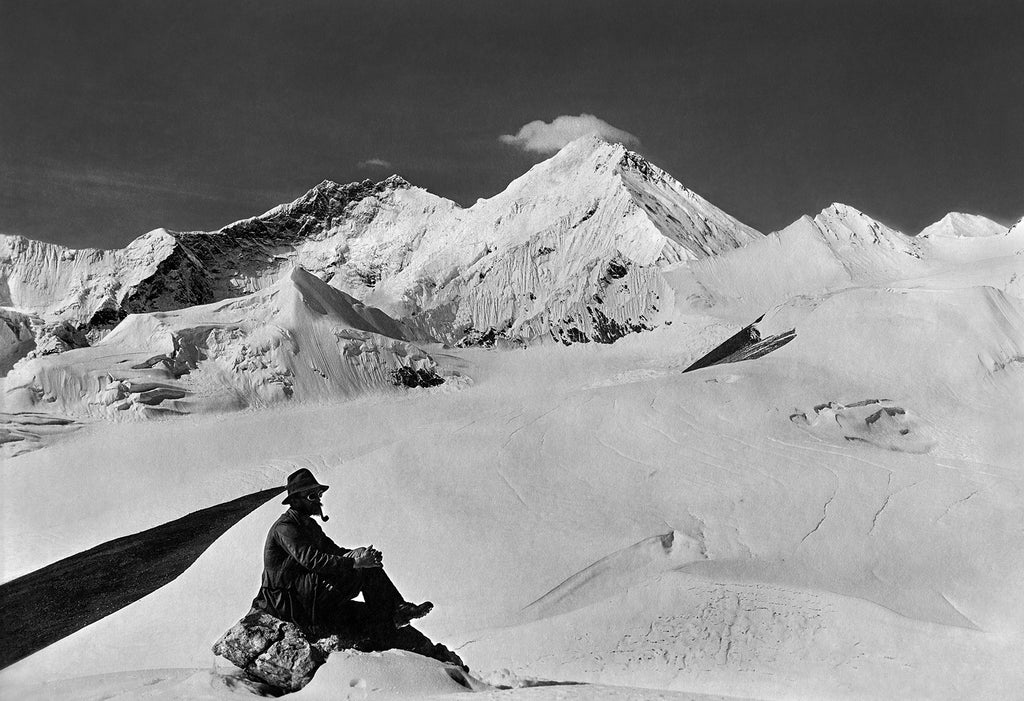 Team member in the foreground with Mount Everest (East side) in the distance
