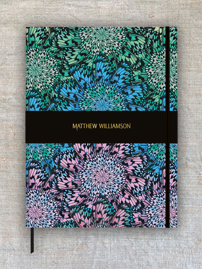 A journal with multi coloured pattern design.