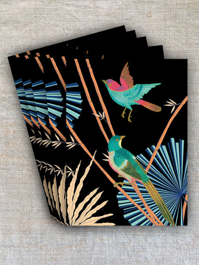 Contrasting bright blues, greens and pinks of the birds amongst the bamboo stands out dramatically against the black background of this card.