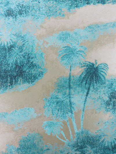 This wallpaper shows silhouettes of swaying island palms in a electric blue and silver