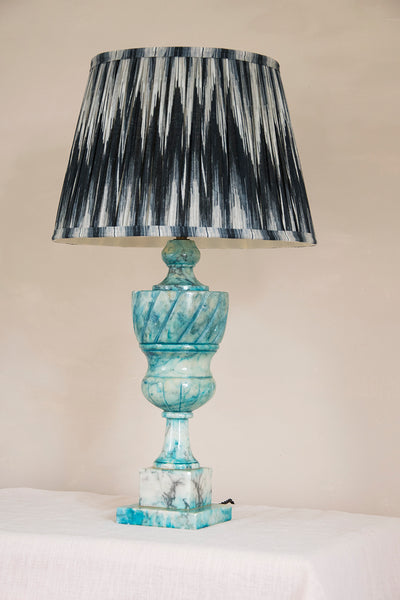 An antique marble lamp base in blue and white. Couples with a black and white lamp shade