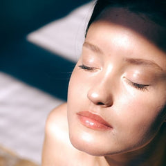 young woman with a clear complexion sunbathing