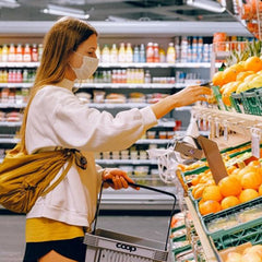 Young woman is picking fruits, healthy diet