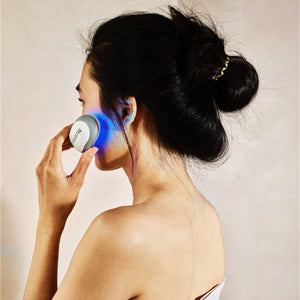 young woman using LUSTRE ClearSkin Solo to treat acne