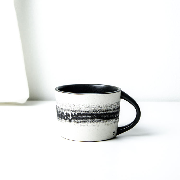 -Latte / Cappuccino Coffee Cup - Black Matt on white porcelain clay -Slight angle with lip to bottom full arch handle -Modern simple shape + natural texture  *Basalt Collection Drawing of mixture of dark minerals. The unique organic drawing is applied in a rotation motion of my wheel.