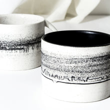 Load image into Gallery viewer, -Latte / Cappuccino Cup  l  Straight Edge  -Black Matt / Clear glaze on white porcelain clay -Straight edged, low and wide opening with lip to bottom arch handle -Modern simple shape + natural texture *Basalt Collection - Drawing of mixture of dark minerals. The unique organic drawing is applied in a rotation of my wheel.