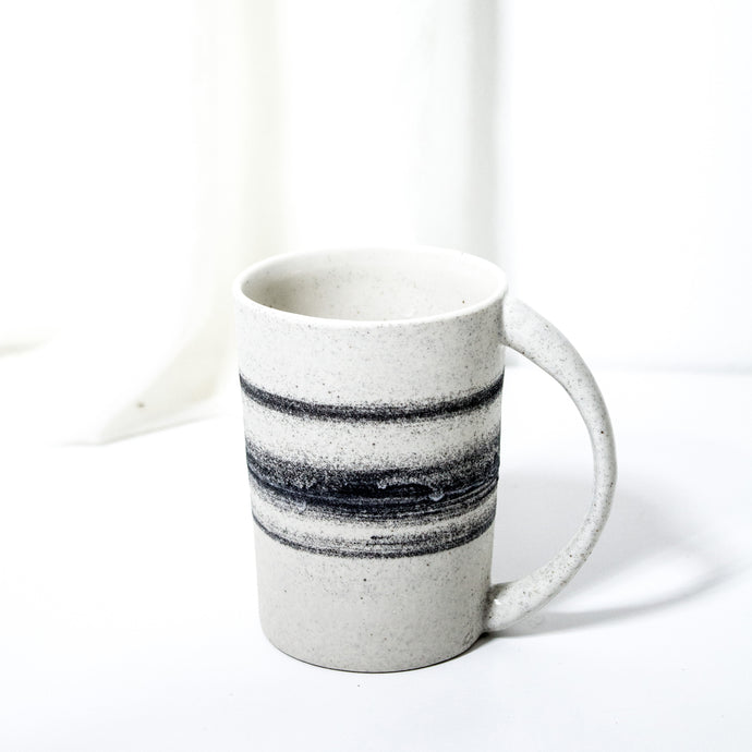 -Americano / Dripped Coffee Cup l Angled -Slight angle toward opening / slim body with lip to bottom, full arch handle -Modern simple shape + natural texture *Basalt Collection Drawing of mixture of dark minerals. The unique organic drawing is applied in a rotation motion of my wheel.