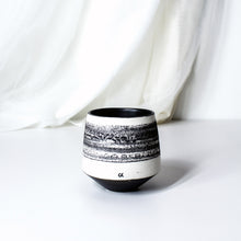 Load image into Gallery viewer, -Thumbprint Cup l Dimple Cup l Coffee / Tea Cup l -Matt black glaze on white porcelain clay -Thumb printed in the belly part -Modern simple shape + natural texture *Basalt Collection Drawing of mixture of dark minerals. The unique organic drawing is applied in a rotation motion of my wheel.