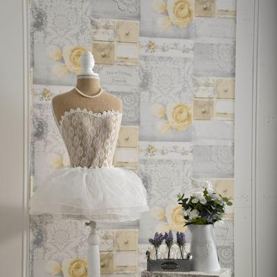 wm146627c Fashionable wallpaper with an elegant collage design in soft yellows and greys.