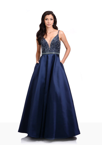 Striking Mikado a-line dress with plunging bodice. Embellished deep v neckline with highlighting waist detail.  Navy prom or evening dress.