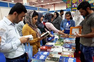 Photo of workers looking at Pathfinder display at book fair