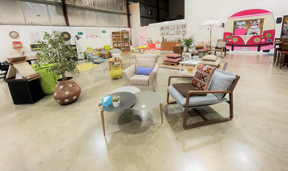 overview of space and furniture in The Doggy Be Collective, with 2 sofa chairs in front