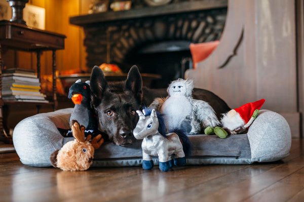 Black German Shepherd is chilling near P.L.A.Y. Willow's Mythical Collection- set of 5. SKU: PY7074AUF. They are all in living room, in front of fireplace on wooden floor