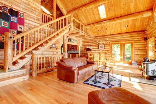 Large luxury log cabin house living room with large staircase