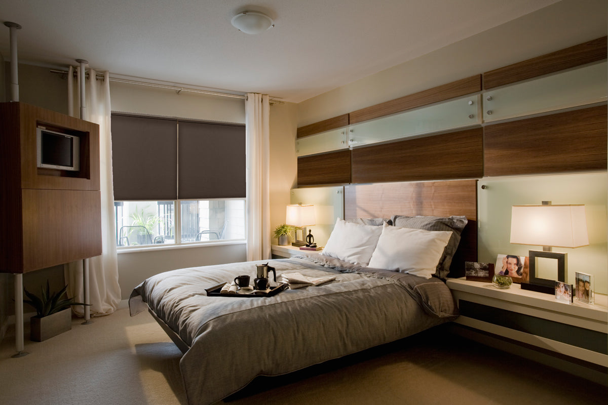 Wood and Glass Panels on Wall Behind Bed