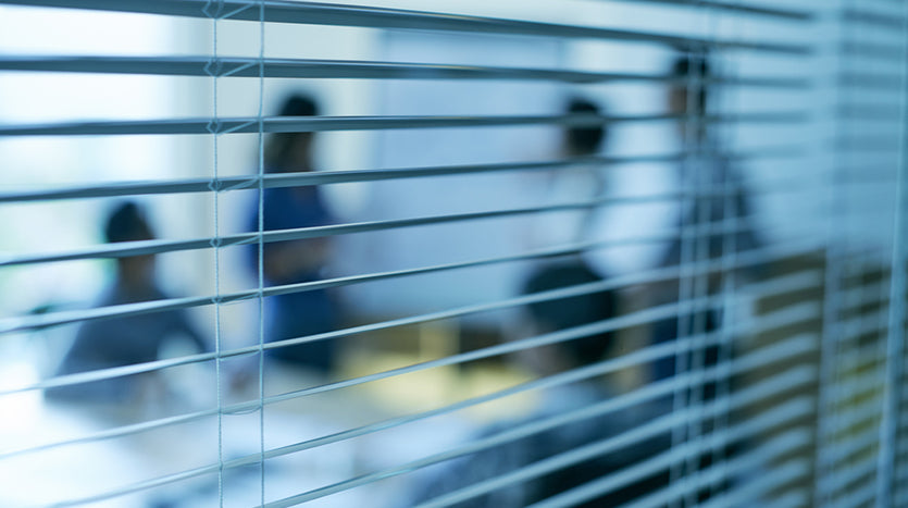 business people meeting through blinds