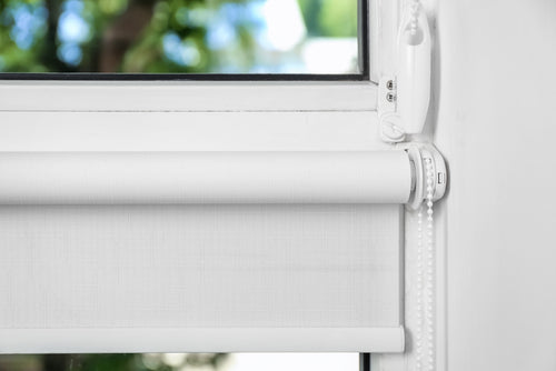 closeup of white roller shade