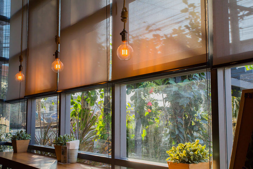 coffee shop windows with roller blinds