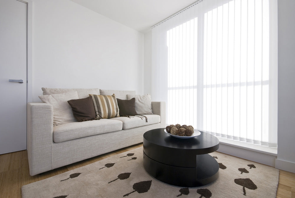 a modern living area with vertical blinds