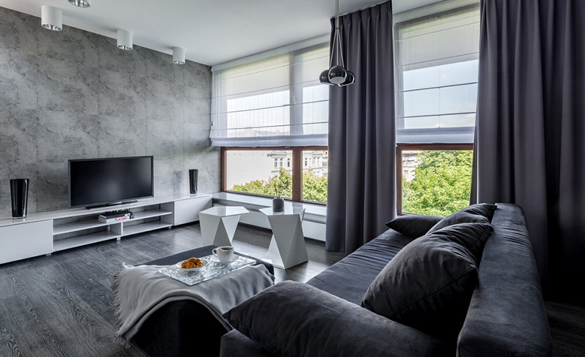 gray themed living room with large windows
