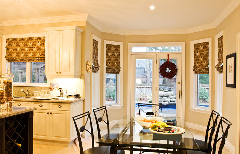 kitchen featuring roman shades