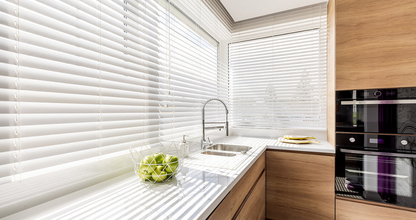 kitchen with white blinds