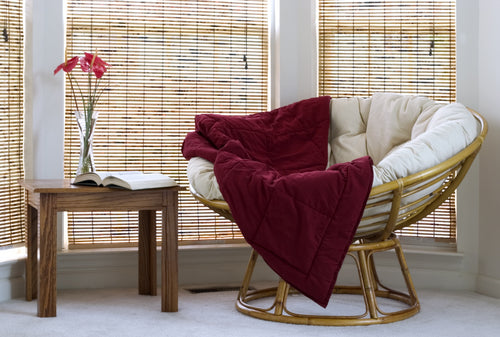living room corner with bamboo blinds