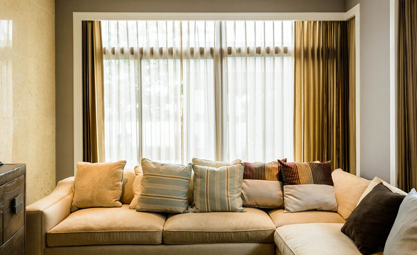 living room with double curtains