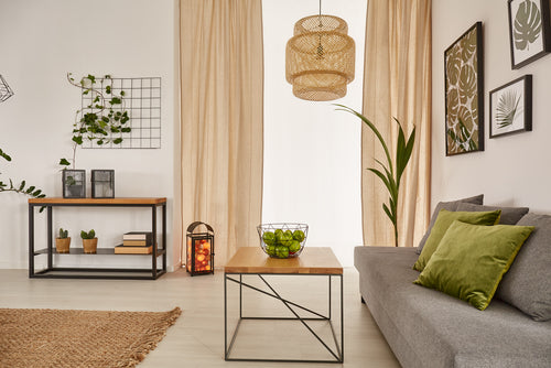 living room with wooden table and gray sofa