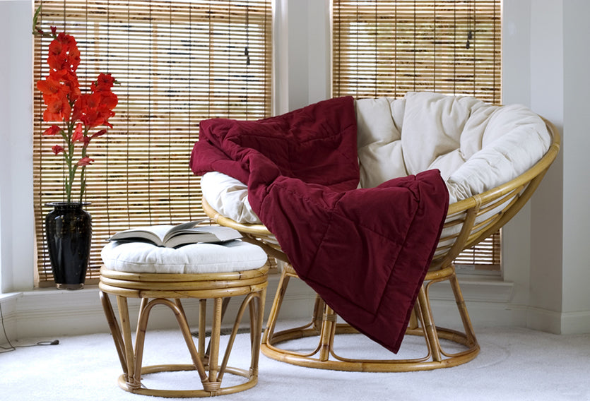 lounge seat with bamboo blinds in background