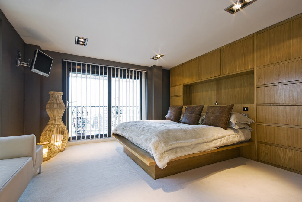 A luxury bedroom with vertical blinds