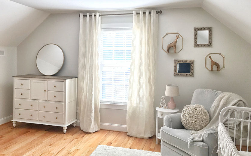nursery with lacy curtains