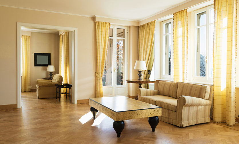room with bright yellow interior and curtains