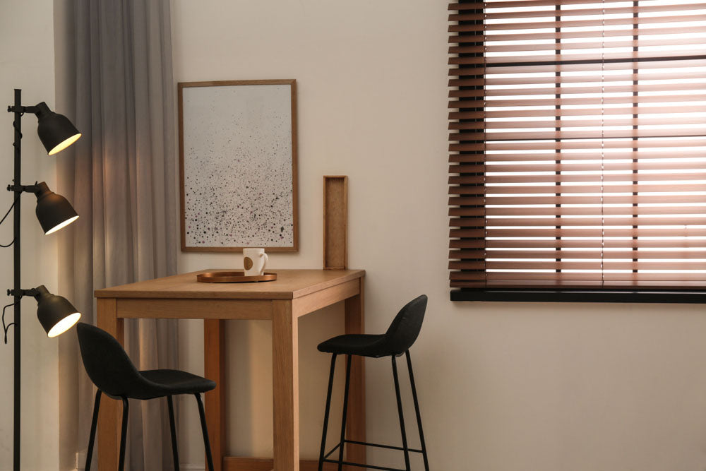 Horizontal blinds in a window next to a breakfast nook